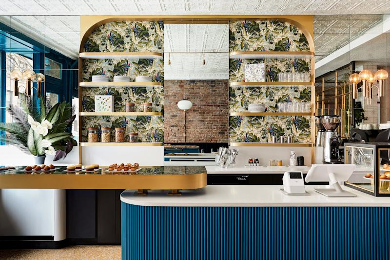 The blue bar is a great focal point among all the pattern and brass. It was custom-made by Rue d'Arch.