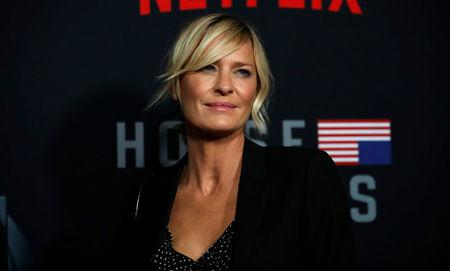 "Cast member Wright poses at a premiere for the television series ""House of Cards"" in Los Angeles"