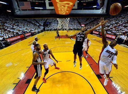 Jun 10, 2014; Miami, FL, USA; San Antonio Spurs forward Boris Diaw (33) rebounds against Miami Heat guard Mario Chalmers (15) during the first half of game three of the 2014 NBA Finals at American Airlines Arena. Mandatory Credit: Steve Mitchell-USA TODAY Sports