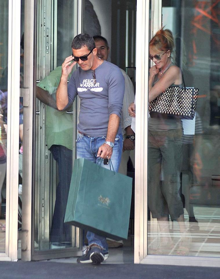 """Antonio Banderas and Melanie Griffith are still romantic after 15 years together! The couple were seen shopping in Marbella, Spain, on Monday -- one day before Melanie's 54th birthday and two days before Antonio's 51st. G Tres/<a href=""""http://www.splashnewsonline.com"""" target=""""new"""">Splash News</a> - August 8, 2011"""