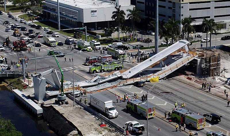 In this March 15, 2018, file photo, emergency personnel respond after a new pedestrian bridge collapsed onto a highway at Florida International University in Miami.