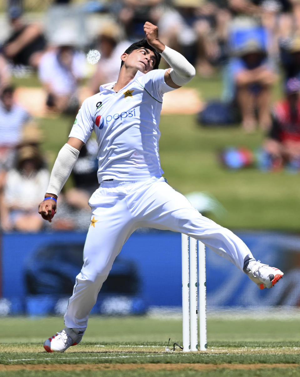 Pakistan's Naseem Shah bowls during play on day two of the first cricket test between Pakistan and New Zealand at Bay Oval, Mount Maunganui, New Zealand, Sunday, Dec. 27, 2020. (Andrew Cornaga/Photosport via AP)