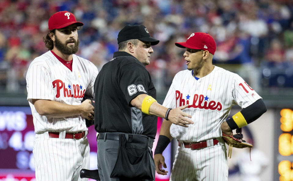"<a class=""link rapid-noclick-resp"" href=""/mlb/teams/phi"" data-ylk=""slk:Phillies"">Phillies</a> relief pitcher <a class=""link rapid-noclick-resp"" href=""/mlb/players/11047/"" data-ylk=""slk:Austin Davis"">Austin Davis</a> and second baseman Cesar Hernandez talk with umpire Marty Foster during the eighth inning against the <a class=""link rapid-noclick-resp"" href=""/mlb/teams/chc"" data-ylk=""slk:Cubs"">Cubs</a> on Saturday in Philadelphia. Umpire Joe West confiscated a card from Davis, while Davis and manager Gabe Kapler said he was using the card merely for information on the Cubs hitters. (AP Photo/Chris Szagola)"