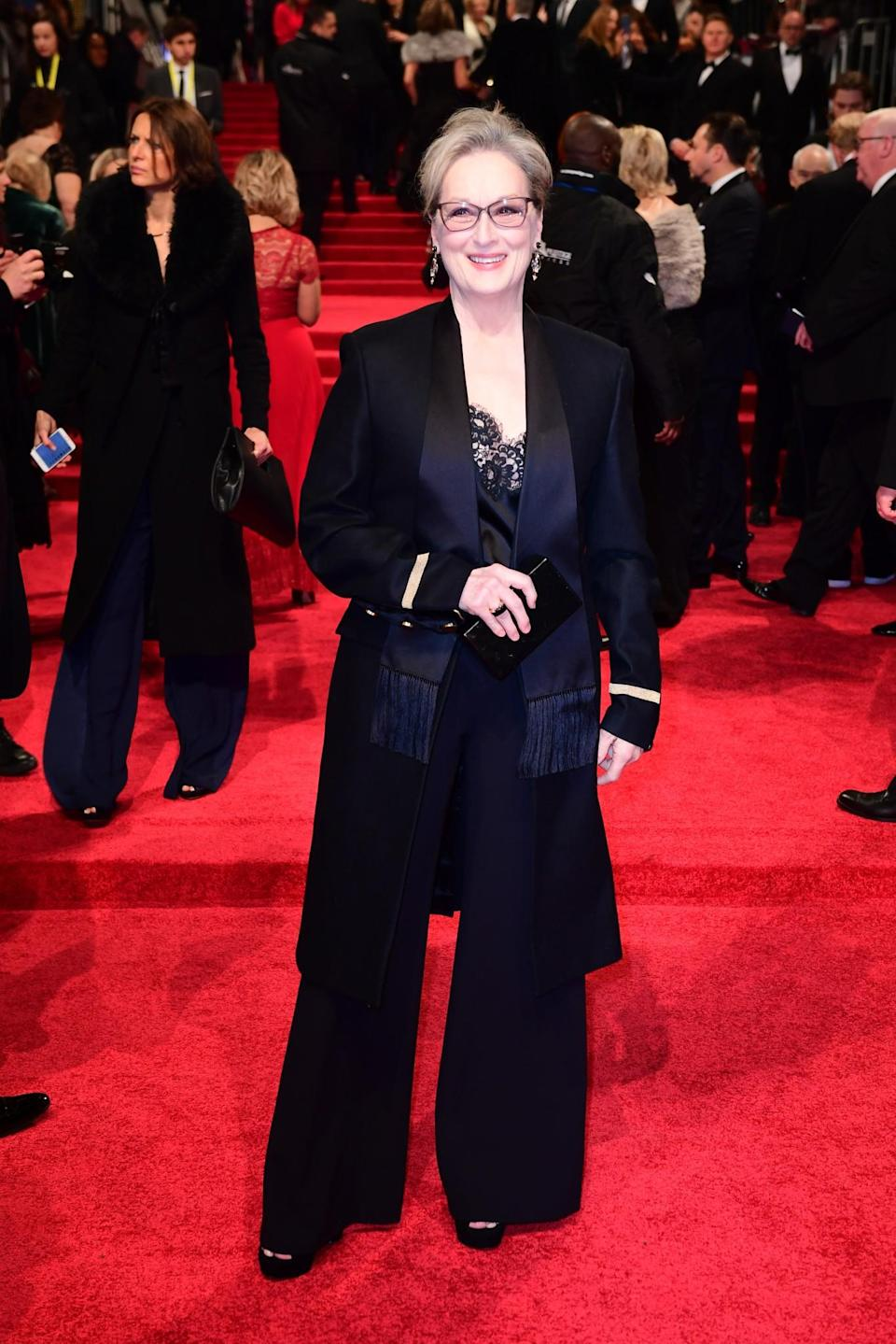 <p>At the 2017 Bafta's Meryl opted for a classic suit, complete with shoulder padded jacket. YAAAS Queen. [Photo: PA] </p>