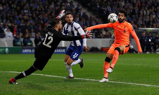 Soccer Football - Champions League Round of 16 First Leg - FC Porto vs Liverpool - Estadio do Dragao, Porto, Portugal - February 14, 2018 Liverpool's Mohamed Salah goes past Porto's Jose Sa before scoring their second goal Action Images via Reuters/Matthew Childs