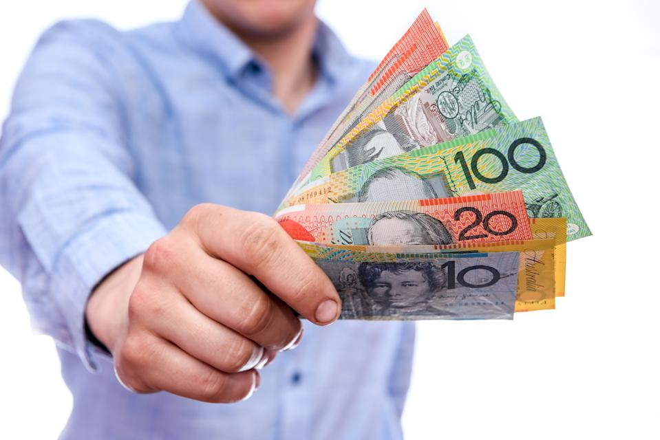 Male hands showing australian dollar banknotes close up