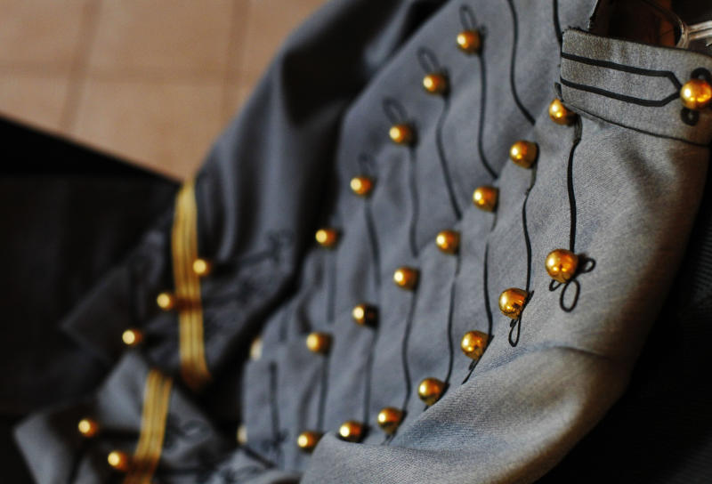 This Dec. 20, 2012 photo shows a detail of the military tunic originally worn by 1971 West Point graduate Joseph Francis Albano. When Mary Helen Taft picked up the jacket on consignment about 20 years ago, she had thought it was an elaborate costume. When the story of an 80-year-old military tunic found among Superstorm Sandy debris at the Jersey Shore made national headlines, Taft realized the item in her closet was not just a run-of-the-mill coat. (AP Photo/Genevieve Ross)