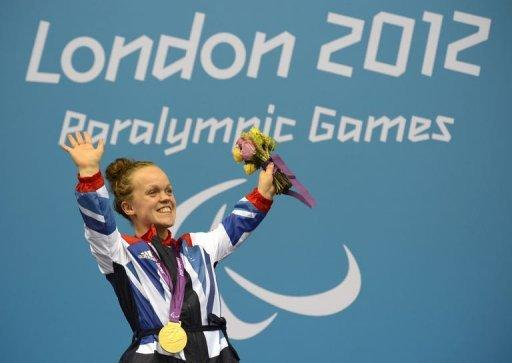Great Britain's Eleanor Simmonds celebrates with her gold medal