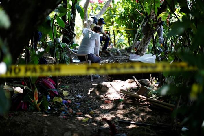 Silvana Turner of Argentine Forensic Anthropology Team (EAAF) watches forensic workers at an exhumation site in the village of Yancolo, as the team searches for human remains of the El Mozote massacre in the town of Cacaopera