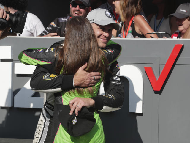 Ed Carpenter is hugged by Danica Patrick after winning the pole during qualifications for the IndyCar Indianapolis 500 auto race at Indianapolis Motor Speedway, in Indianapolis Sunday, May 20, 2018. (AP Photo/Michael Conroy)