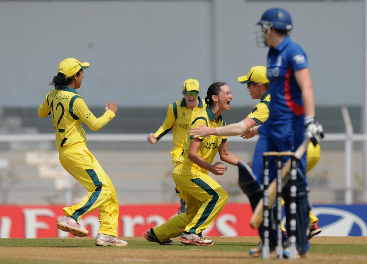 MUMBAI, INDIA - FEBRUARY 08:  Julie Hunter of Australia celebrates the wicket of Heather Knight of Egnland during the super six match  between England and Australia held at the CCI (Cricket Club of India)  on February 8, 2013 in Mumbai, India.  (Photo by Pal Pillai/Getty Images)