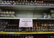 A notice calling for a boycott French products is displayed at a supermarket in Sanaa, Yemen, Monday, Oct. 26, 2020. Muslims in the Middle East and beyond on Monday called for boycotts of French products and for protests over caricatures of the Prophet Muhammad they deem insulting and blasphemous, but France's president has vowed his country will not back down from its secular ideals and defense of free speech. (AP Photo/Hani Mohammed)