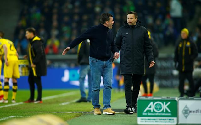Soccer Football - Bundesliga - Borussia Moenchengladbach vs Borussia Dortmund - Borussia-Park, Moenchengladbach, Germany - February 18, 2018 Borussia Monchengladbach coach Dieter Hecking remonstrates with the fourth official REUTERS/Thilo Schmuelgen DFL RULES TO LIMIT THE ONLINE USAGE DURING MATCH TIME TO 15 PICTURES PER GAME. IMAGE SEQUENCES TO SIMULATE VIDEO IS NOT ALLOWED AT ANY TIME. FOR FURTHER QUERIES PLEASE CONTACT DFL DIRECTLY AT + 49 69 650050