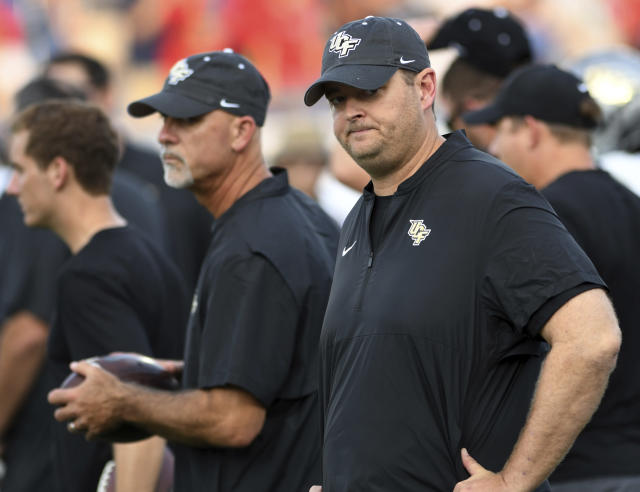 UCF coach Josh Heupel looks over his team before an NCAA college football game against Florida Atlantic on Saturday, Sept. 7, 2019, in Boca Raton, Fla. (AP Photo/Jim Rassol)
