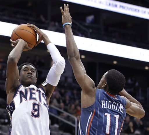 New Jersey Nets' MarShon Brooks (9) shoots against Charlotte Bobcats' Cory Higgins (11) during the first quarter of an NBA basketball game, Sunday, Jan. 22, 2012, in Newark, N.J. (AP Photo/Julio Cortez)