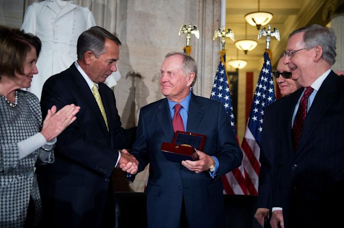 Golf legend Jack Nicklaus, center, is presented the Congressional Gold Medal by, from left, House Minority Leader Nancy Pelosi (D-Calif.), Speaker John Boehner (R-Ohio), Senate Minority Leader Harry Reid (D-Nev.) and Senate Majority Leader Mitch McConnell (R-Ky.) in the Capitol Rotunda on March 24, 2015.