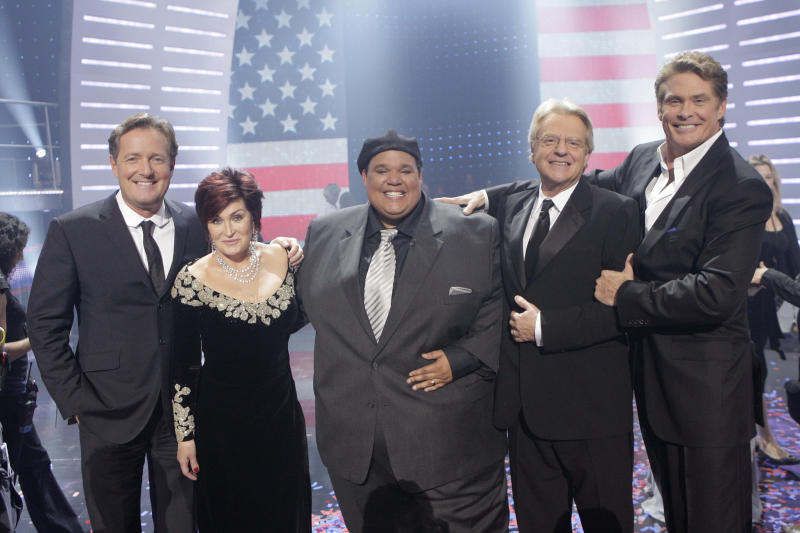 """In this Sept. 24, 2008 file image released by NBC,  opera singer Neal E. Boyd, center, is flanked by, from left: judges Piers Morgan and Sharon Osbourne, host Jerry Springer and judge David Hasselhoff  after winning the NBC talent competition, """"America's Got Talent,"""" in Studio City, Calif.  The Southeast Missourian reports that Boyd, of Sikeston, Mo.,  will seek election as a Republican in the newly drawn 149th Missouri House District. Missouri Lt. Gov. Peter Kinder made the announcement Saturday at a Cape Girardeau County Lincoln Day event.  Boyd is the first GOP candidate to announce his intention to seek that seat. Democratic state Rep. Steve Hodges also plans to run. (AP Photo/NBC, Chris Haston, file)"""