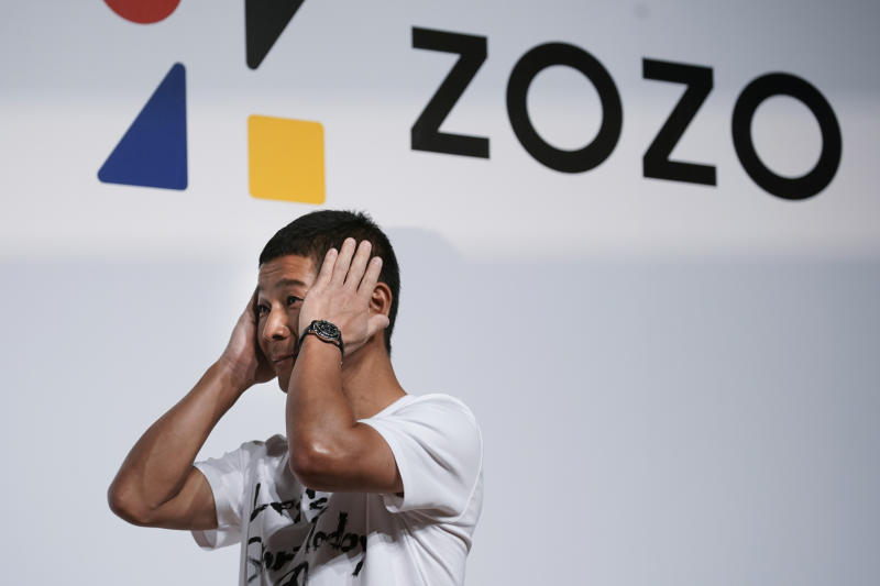 Zozo founder, Yusaku Maezawa, gets emotional as he speaks during a news conference Thursday, Sept. 12, 2019, in Tokyo. Yahoo Japan Corp. said Thursday it will put up a tender offer, estimated at 400 billion yen ($3.7 billion), for Zozo Inc., a Japanese online retailer started by a celebrity tycoon. (AP Photo/Jae C. Hong)