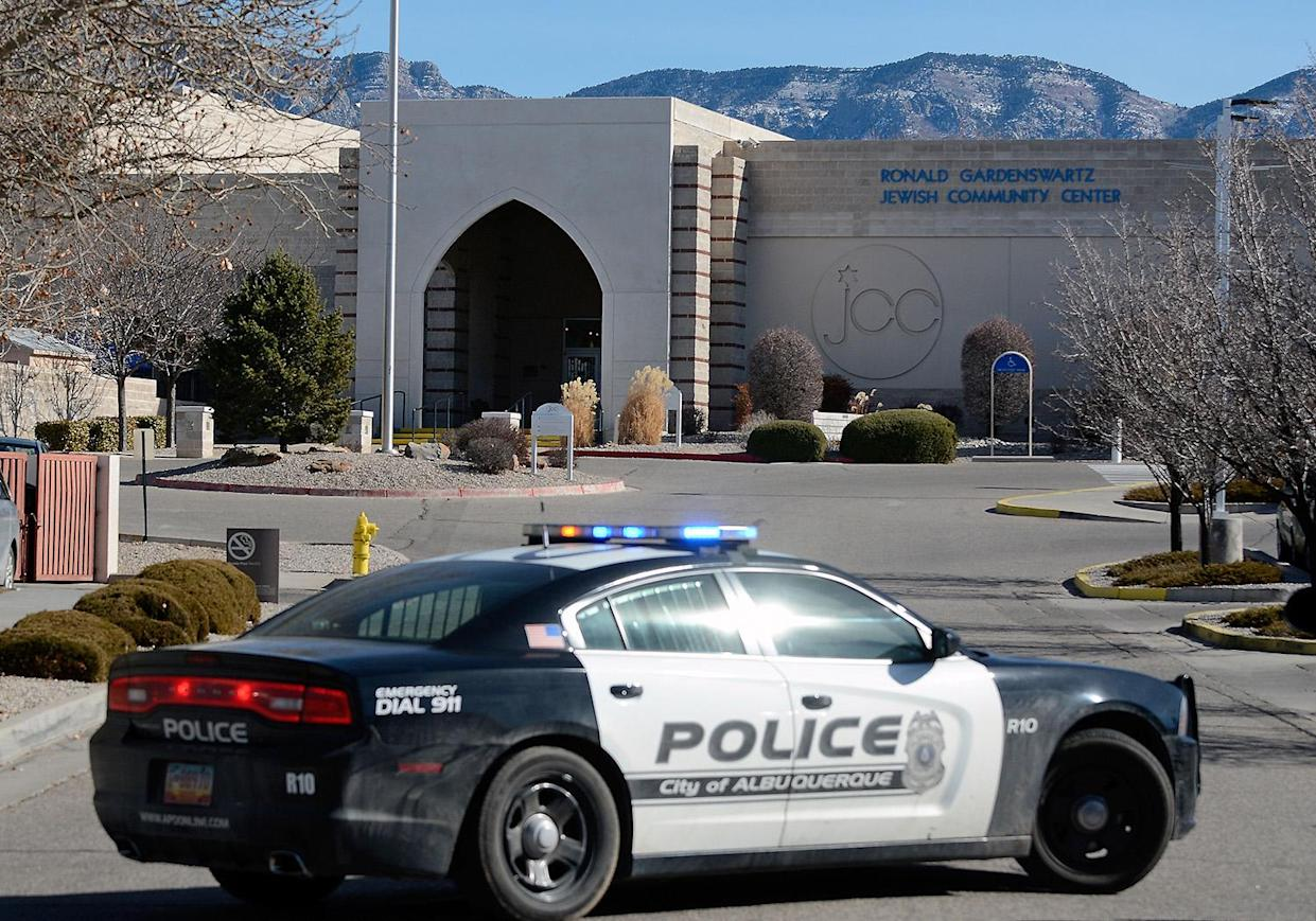 A police car is parked in front of the Ronald Gardenswartz Jewish Community Centerin Albuquerque after it was closed down and evacuated following a bomb scare on Jan. 31. (Photo: Jim Thompson/Albuquerque Journal via ZUMA Wire)