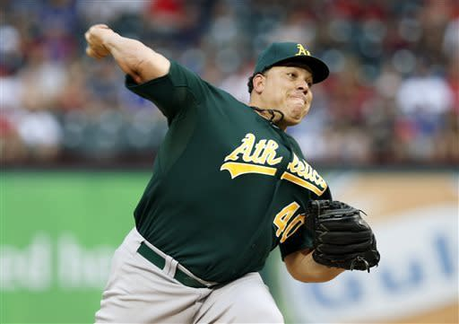 Oakland Athletics starting pitcher Bartolo Colon (40) throws to the Texas Rangers during the first inning of a baseball game, Monday, May 20, 2013, in Arlington, Texas. (AP Photo/Jim Cowsert)