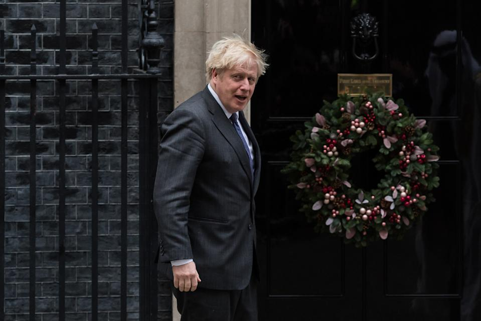 British Prime Minister Boris Johnson gestures as he welcomes Sheikh Mohammed bin Zayed Al Nahyan (not pictured), the Crown Prince of the Emirate of Abu Dhabi, outside 10 Downing Street ahead of bilateral talks, on 10 December, 2020 in London, England. (Photo by WIktor Szymanowicz/NurPhoto via Getty Images)