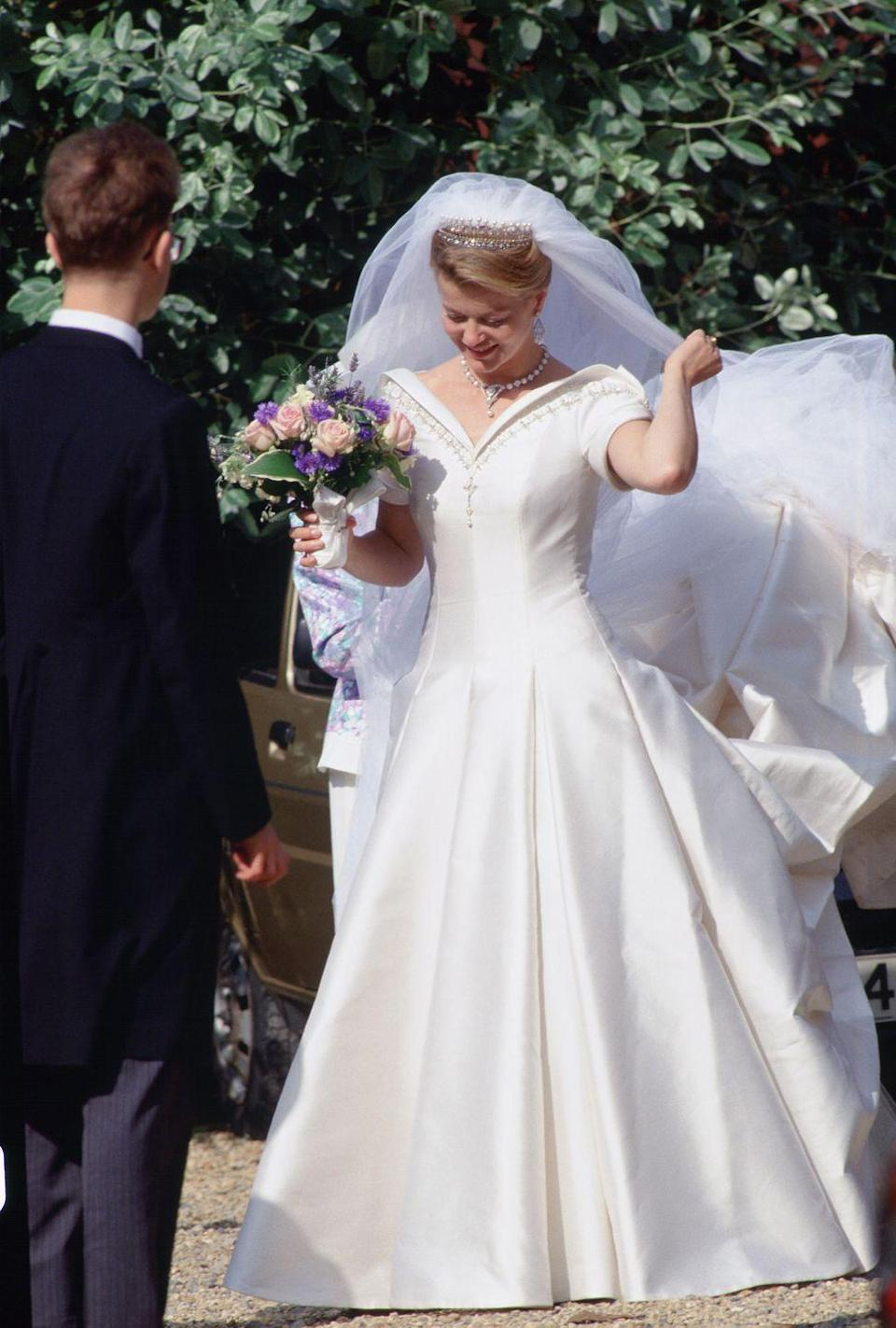 <p>Lady Helen Windsor stunned in a bespoke Catherine Walker bridal gown for her wedding to Timothy Taylor. The bride's Tudor-style gown featured structured off-the-shoulder sleeves and gold embroidery details. </p>