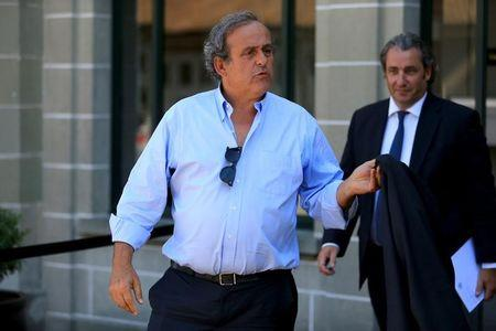 FILE PHOTO: Former UEFA President Michel Platini (L) leaves the Court of Arbitration for Sport (CAS) after being heard in the arbitration procedure involving him and the FIFA in Lausanne, Switzerland, August 25, 2016. REUTERS/Pierre Albouy