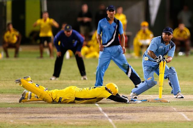 ALICE SPRINGS, AUSTRALIA - FEBRUARY 15: Bevan Bennell of Western Australia slides to score the winning runs during the Imparja Cup Final between Western Australia and New South Wales at Traeger Park on February 15, 2014 in Alice Springs, Australia. (Photo by Darrian Traynor/Getty Images)