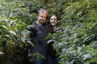 Chip and Jessica Baker pose for a photo at their marijuana nursery at Baker's Medical, Wednesday, Feb. 26, 2020, in Oklahoma City. When voters in conservative Oklahoma approved medical marijuana in 2018, many thought the rollout would be ploddingly slow and burdened with bureaucracy. Instead, business is booming so much cannabis industry workers and entrepreneurs are moving to Oklahoma from states with more well-established pot cultures, like California, Colorado and Oregon. (AP Photo/Sue Ogrocki)