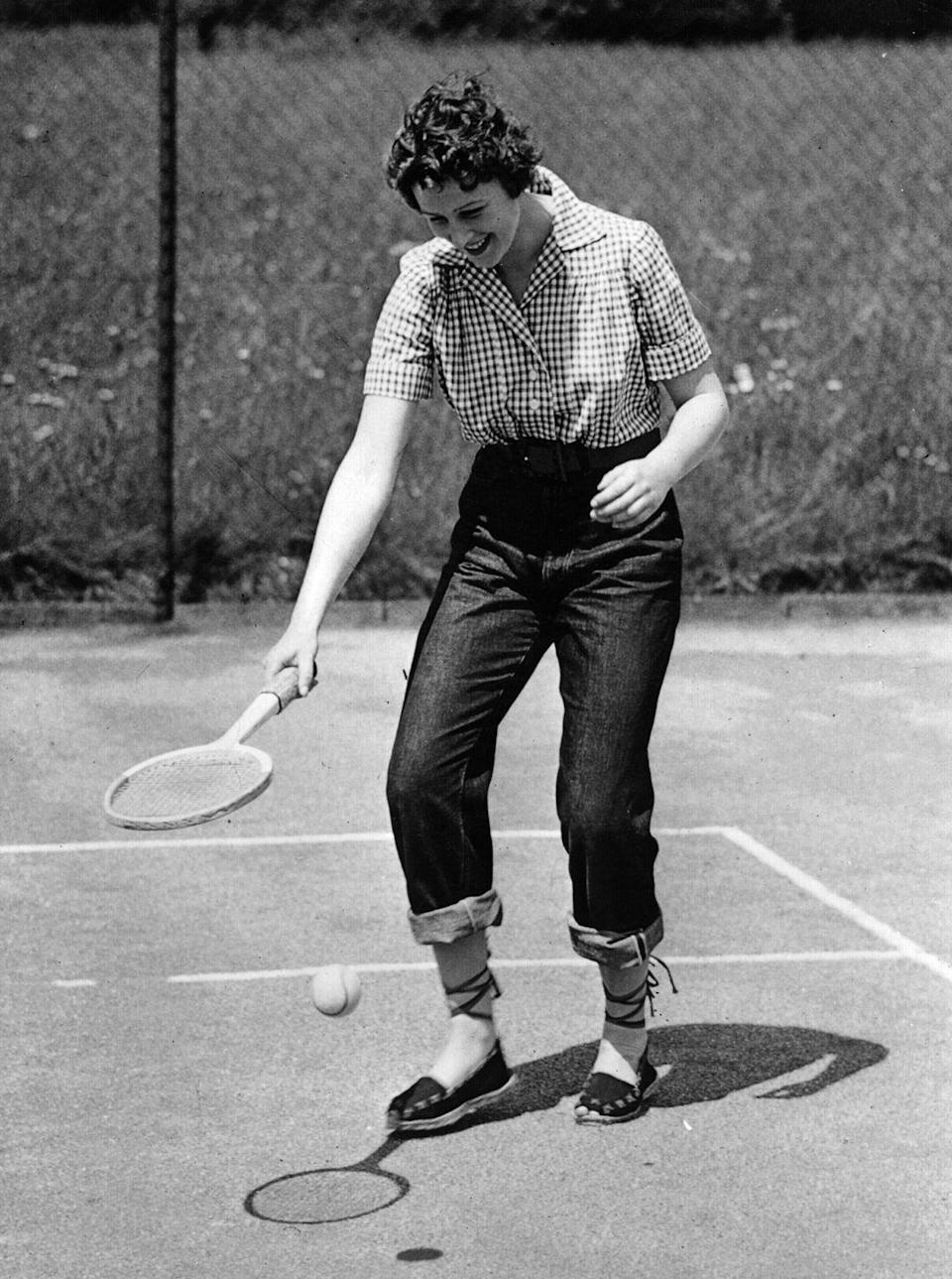 <p> Princess Diana is often credited as being the first Princess to publicly wear jeans, but that's not true: Here Princess Alexandra of Kent wears jeans to play tennis at her family home in Buckinghamshire. Jeans as activewear: how far we've come. </p>