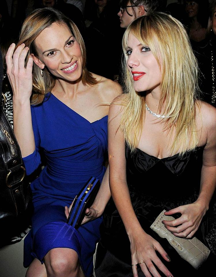 """Hilary Swank, in an asymmetrical Elie Saab Fall 2009 dress with matching blue clutch, joined """"Inglourious Basterds"""" actress Melanie Laurent in the front row to view a collection from Etam designed by the model Natalia Vodianova. Pascal Le Segretain/<a href=""""http://www.gettyimages.com/"""" target=""""new"""">GettyImages.com</a> - January 25, 2010"""