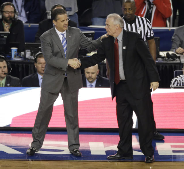 Kentucky head coach John Calipari, left, greets Wisconsin head coach Bo Ryan before an NCAA Final Four tournament college basketball semifinal game Saturday, April 5, 2014, in Arlington, Texas.(AP Photo/Tony Gutierrez)