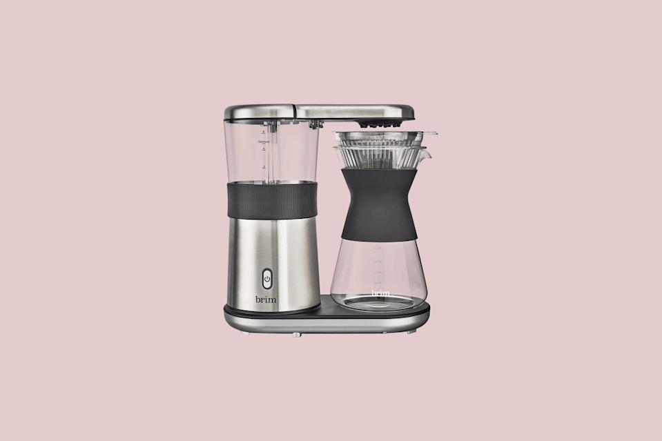 """<p>Move over manual. A joy for pour-over lovers, this automatic, one-button coffee maker with stainless-steel accents and a glass carafe features a pour-over showerhead that allows for even saturation and pulse brew for full blooming, plus a precise heater that quickly reaches and maintains the ideal temperature.</p> <p><strong><em>Buy Now</em></strong><em>: Brim 8-Cup Pour-Over Coffee Maker, $164.99, <a href=""""https://goto.target.com/c/249354/81938/2092?subId1=MSLBrewingPerfectionOurShoppableGuidetotheBestCoffeeMakersvspence2FooGal7987783202009I&u=https%3A%2F%2Fwww.target.com%2Fp%2Fbrim-8-cup-pour-over-coffee-maker-silver%2F-%2FA-80557553"""" rel=""""nofollow noopener"""" target=""""_blank"""" data-ylk=""""slk:target.com"""" class=""""link rapid-noclick-resp"""">target.com</a></em></p>"""