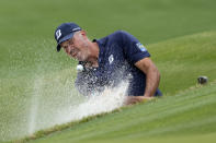 Matt Kuchar hits from the sand on the No. 6 hole during a round of eight match at the Dell Technologies Match Play Championship golf tournament Saturday, March 27, 2021, in Austin, Texas. (AP Photo/David J. Phillip)