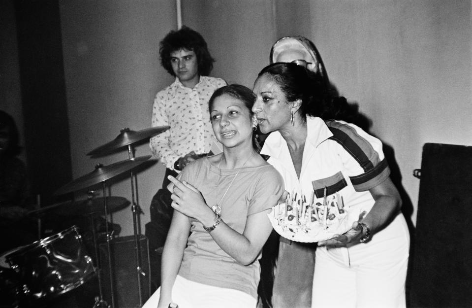 Lolita Flores, daughter of Spanish singer and dancer Lola Flores, with her mother the day of her 18th birthday. 1976, Madrid, Castilla La Mancha, Spain. (Photo by Gianni Ferrari/Cover/Getty Images).