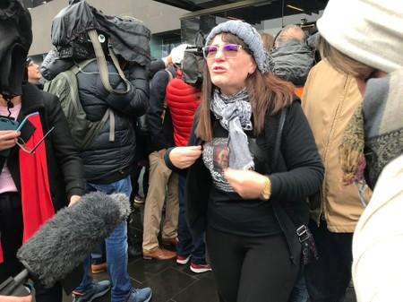 FILE PHOTO: Janna Ezat, wearing a T-shirt in memorial of her son who was killed at Al Noor mosque on March 15, reacts outside the Christchurch High Court after accused gunman Brenton Tarrant pleaded not guilty to all charges, New Zealand