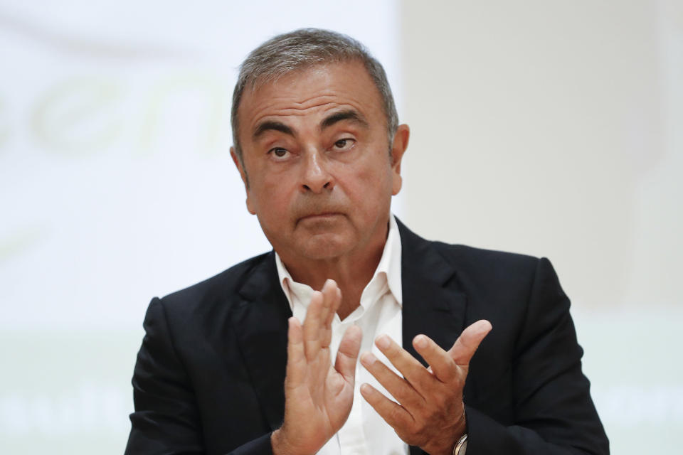 FILE - In this Sept. 29, 2020, file photo, Nissan's former executive Carlos Ghosn attends a press conference at the Holy Spirit University of Kaslik (USEK), north of Beirut, Lebanon. The trial of two Americans, Michael Taylor and his son Peter, accused of helping former Nissan Chairman Carlos Ghosn escape from Japan while out on bail will open on June 14, the Tokyo District Court said Wednesday, April 28, 2021. (AP Photo/Hussein Malla, File)