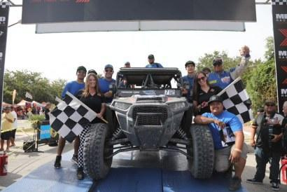Prudhomme, Jones and their team celebrate after reaching the finish line in the NORRA Mexican 1000.