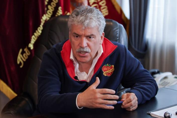 Russian politician and entrepreneur Pavel Grudinin gives an interview outside Moscow
