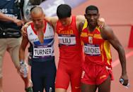 LONDON, ENGLAND - AUGUST 07: Xiang Liu of China gets assisted off the track by Andrew Turner of Great Britain and Jackson Quinonez of Spain after getting injured in the Men's 110m Hurdles Round 1 Heats on Day 11 of the London 2012 Olympic Games at Olympic Stadium on August 7, 2012 in London, England. (Photo by Cameron Spencer/Getty Images)
