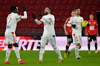 Memphis Depay (C) celebrates after scoring as Lyon came from two goals down to draw 2-2 at Rennes, a result which kept them top of Ligue 1