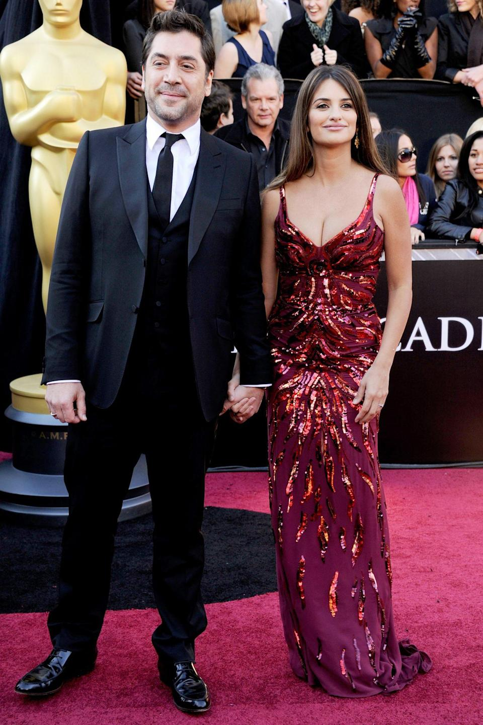 """<p>Javier Bardem and Penélope Cruz <a href=""""https://people.com/awards/oscar-red-carpet-2011-javier-bardem-and-penelope-cruz/"""" rel=""""nofollow noopener"""" target=""""_blank"""" data-ylk=""""slk:hit the red carpet for the first time"""" class=""""link rapid-noclick-resp"""">hit the red carpet for the first time</a> since welcoming their son in January of that year. </p>"""