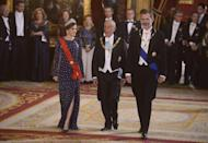 <p>The Queen pulled out all the stops at a dinner gala for President of Portugal, Marcelo Rebelo de Sousa. She chose a pearl-detailed navy gown and accessorized with a red sash and elaborate tiara.</p>