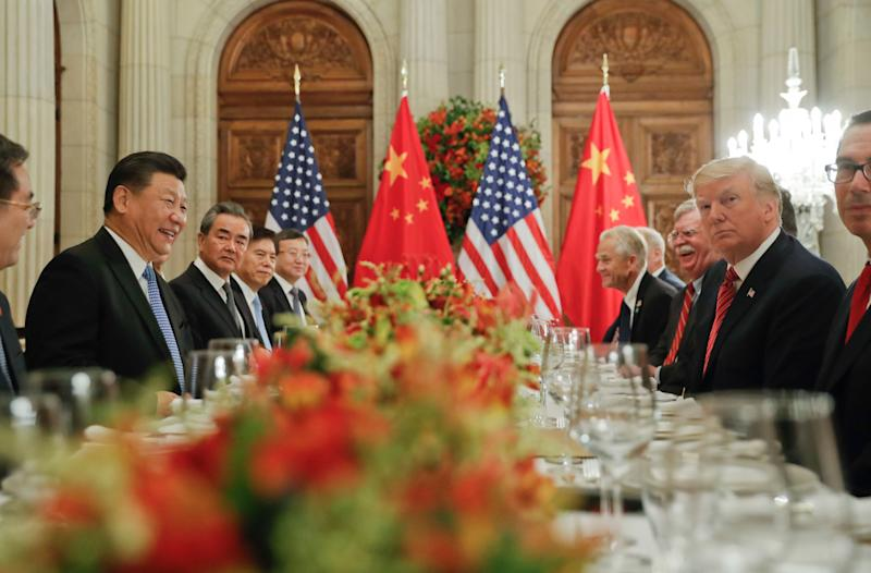 In this Dec. 1, 2018, photo, President Donald Trump, second from right, meets with China's President Xi Jinping, second from left, during their bilateral meeting at the G20 Summit, in Buenos Aires, Argentina. China promised Wednesday, Dec. 5, 2018, to carry out a tariff cease-fire with Washington but gave no details that might help dispel confusion about what Presidents Xi and Trump agreed to in Argentina.(AP Photo/Pablo Martinez Monsivais, File)