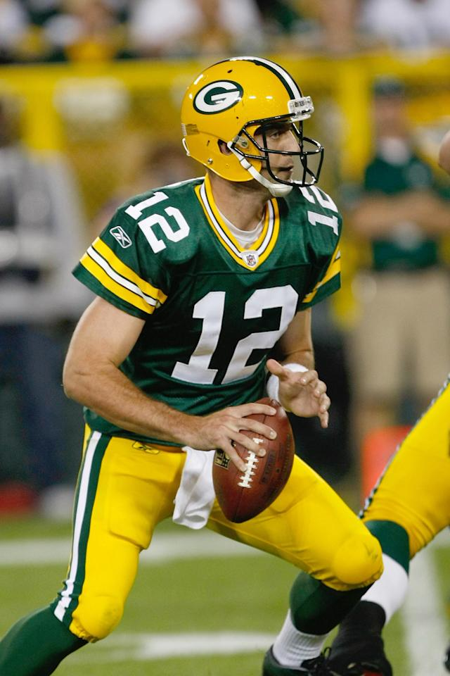 GREEN BAY, WI - SEPTEMBER 8: Aaron Rogers #12 of the Green Bay Packers runs with the football during the game against the New Orleans Saints at Lambeau Field on September 8, 2011 in Green Bay, Wisconsin. The Saints defeated the Packers 42-34. (Photo by Scott Boehm/Getty Images)