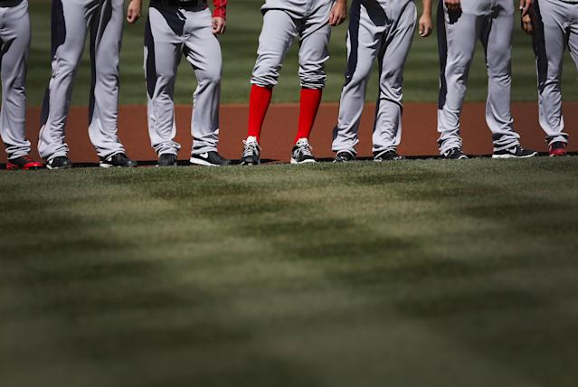 Boston Red Sox relief pitcher Burke Badenhop, center, stands with teammates after being introduced before an opening day baseball game against the Baltimore Orioles, Monday, March 31, 2014, in Baltimore. (AP Photo/Patrick Semansky)