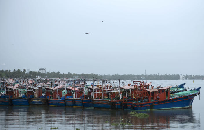 Fishing boats that stayed off the Arabian Sea due to Cyclone Tauktae are anchored in the backwaters in Kochi, Kerala state, India, Sunday, May 16, 2021. A severe cyclone is roaring in the Arabian Sea off southwestern India with winds of up to 140 kilometers per hour (87 miles per hour), already causing heavy rains and flooding that have killed at least four people, officials said Sunday. (AP Photo/R S Iyer)