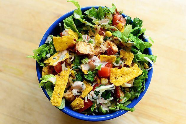 """<p>Ree's chicken taco salad is dressed with a mix of salsa and ranch dressing, but you can also create a refried bean dressing: Just mix ranch dressing with a spoonful of refried beans! Alternatively, just plop a dollop of refried beans onto your salad. </p><p><a href=""""https://www.thepioneerwoman.com/food-cooking/recipes/a11110/chicken-taco-salad/"""" rel=""""nofollow noopener"""" target=""""_blank"""" data-ylk=""""slk:Get Ree's recipe."""" class=""""link rapid-noclick-resp""""><strong>Get Ree's recipe. </strong></a></p>"""