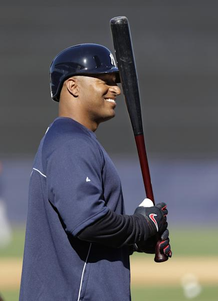 New York Yankees' Vernon Wells holds a bat while waiting his turn in the cage after signing with the Yankees, before a spring training baseball game against the Houston Astros at Steinbrenner Field in Tampa, Fla., Tuesday, March 26, 2013. (AP Photo/Kathy Willens)