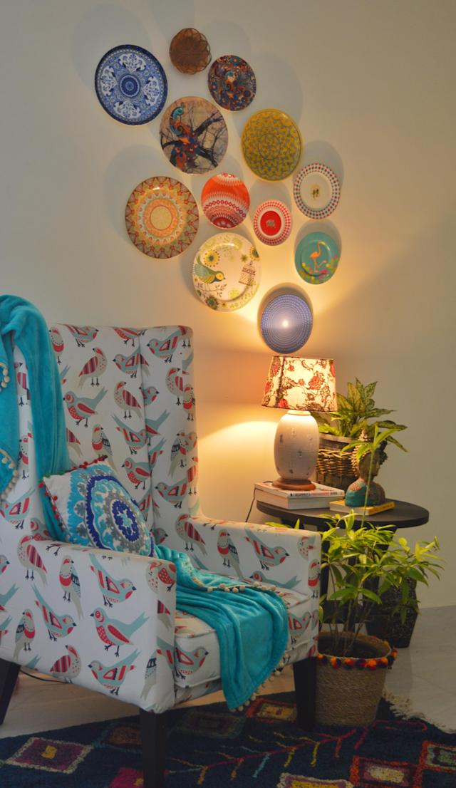 Another view of the living area features a collection of decorative plates.